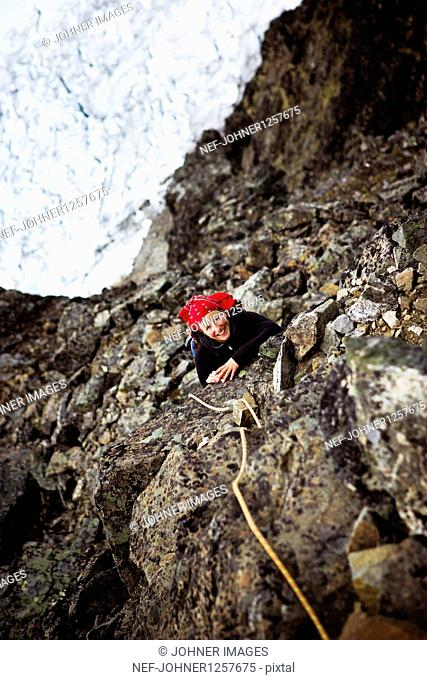Woman climbing on cliff
