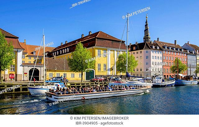 An excursion boat in Christianhavns Canal, Christianshavn, Copenhagen, Denmark