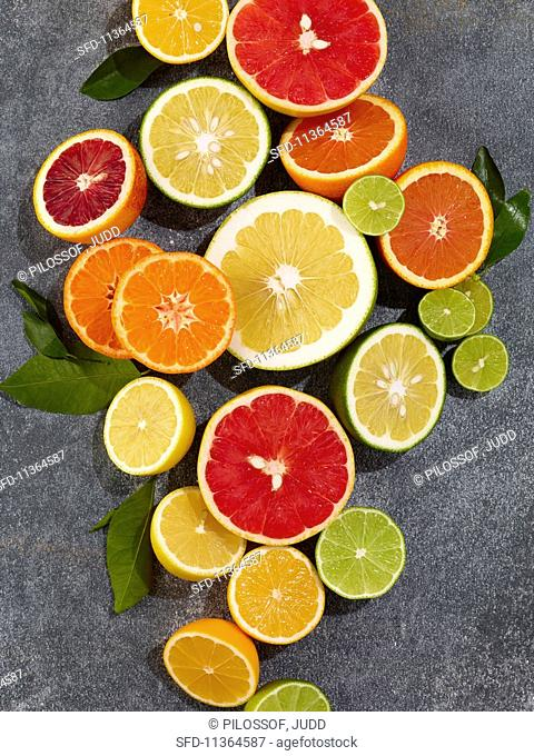 Various halved citrus fruits (seen from above)