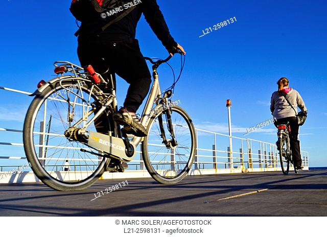 Two cyclists, two bicycles, blue sky