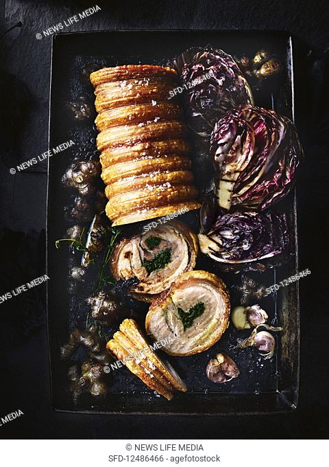 Porchetta (rolled pork belly) with a garlic and herb filling