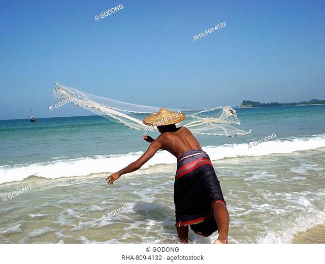 Fisherman throwing his net, Ngapali, Myanmar, Asia
