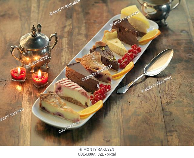 Mixed platter of cakes and tarts amongst festive decorations
