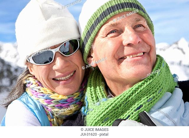 Close up of smiling couple wearing stocking-caps