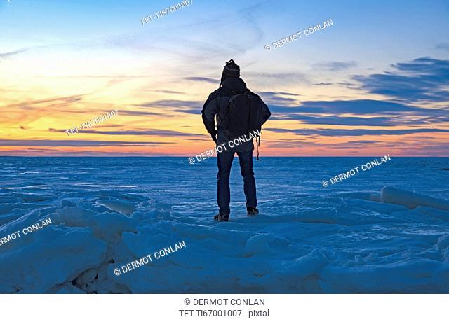 USA, Massachusetts, Eastham, Cape Cod, Rear view of mature man looking at sea at sunset