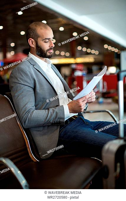 Businessman reading a document in waiting area