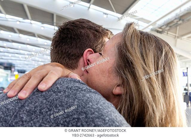 A Young Man Says Goodbye To His Mother To Go Travelling, Heathrow Airport, UK