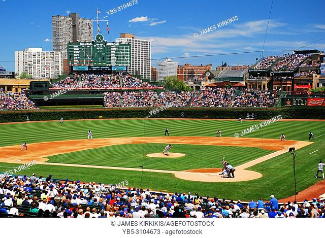 On a beautiful sunny day, the Wrigley Field faithful watch their beloved Chicago Cubs