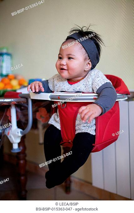 6-month old baby. This little Tahitian girl was adopted by people from the mainland of France