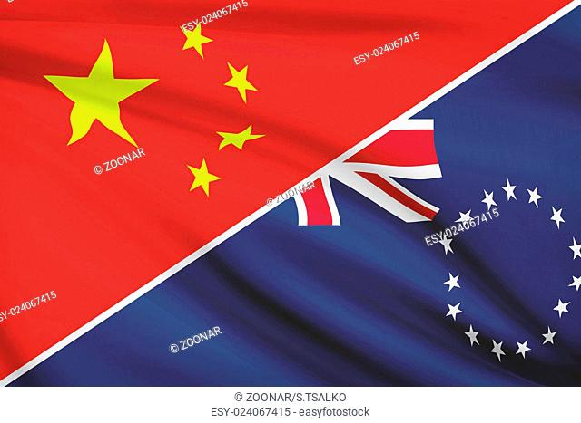 Flags of China and Cook Islands blowing in the wind. Part of a series