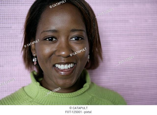 Portrait of woman wearing a green sweater