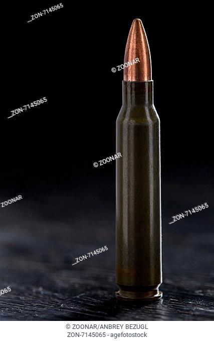 One bullet for a Kalashnikov 7.62mm on a black background