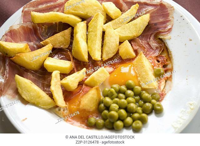 Spanish dish Serrano ham with fries and eggs
