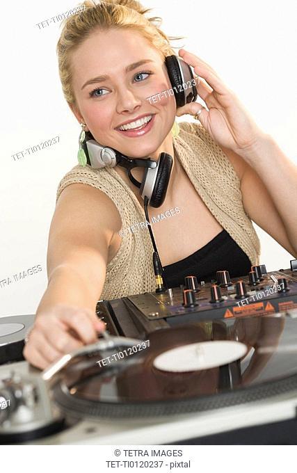 DJ working at music mixing board