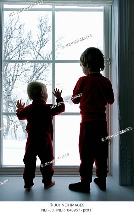 Silhouettes of children in window