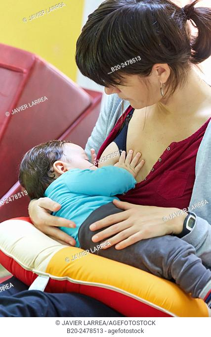 Mother breastfeeding baby in ambulatory area