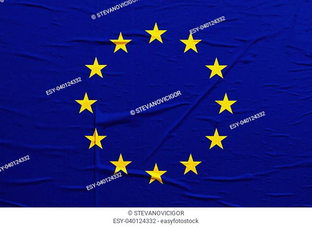 Grunge blue Europian Union flag with yellow stars overlaying a grungy texture