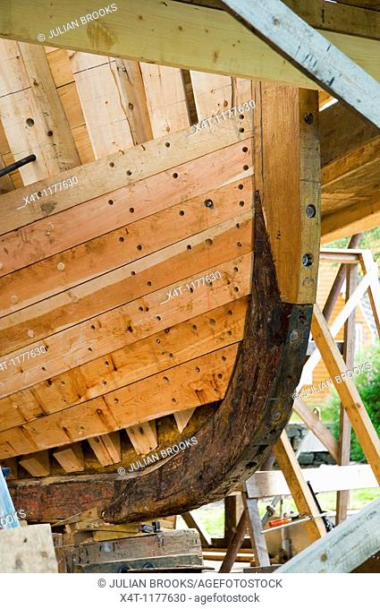 detail showing how planking is attached to the ribs of a traditionally built wooden boat  Marine museum, Norheimsund, Norway