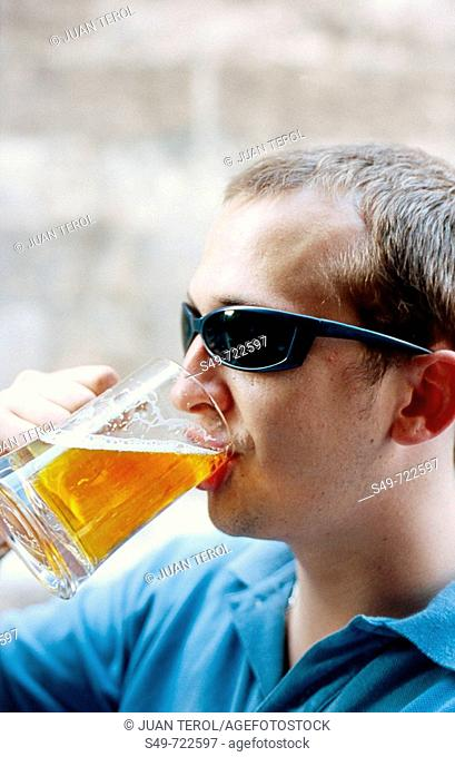 Young drinking beer