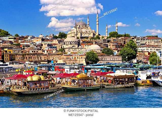 The Suleymaniye Mosque (Süleymaniye Camii, 1550-1558) on the Third Hill and boats selling cooked fish on the banks of the Golden Horn, Istanbul Turkey