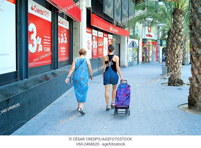 -Mother and Daughter walking to supermarket- Alicante Spain