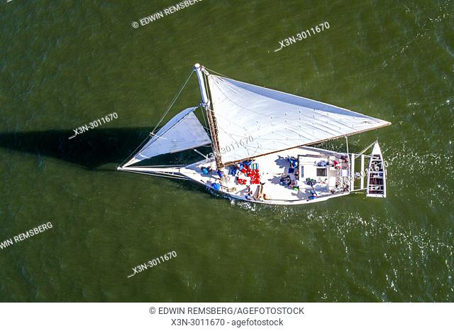 View from directly above traditional Skipjack boat as it coasts along the Chesapeake Bay waters, Deal Island, Maryland. USA