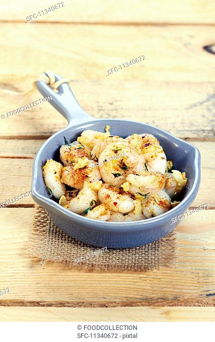 Fried prawns and scampi with herbs