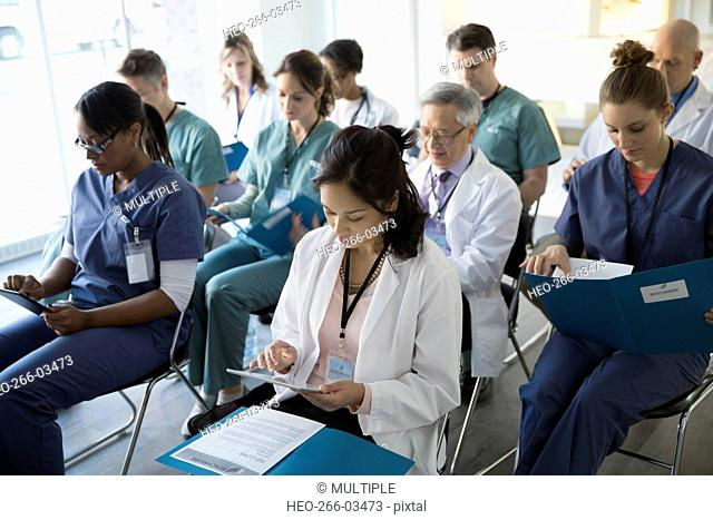 Doctors and nurses in seminar audience