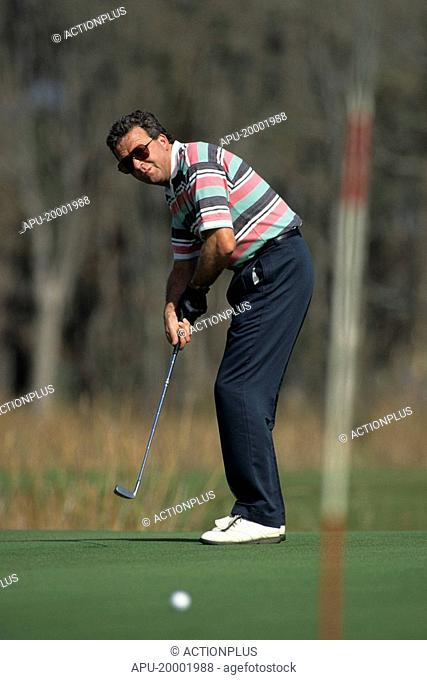 Golfer putting on the green