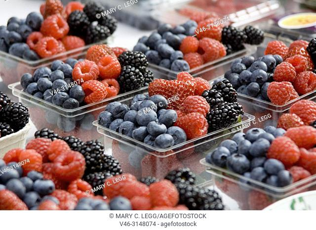 Fresh berry baskets with blackberries, blueberries, raspberries and strawberries in Havelska Market, Prague