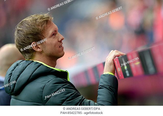 Coach Julian Nagelsmann of Hoffenheim sitzt sits on the coaching bench before the match between FC Bavaria Munich and 1899 Hoffenheim on the tenth match day of...