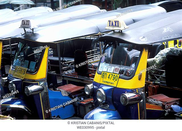 Tuk-Tuk Taxis waiting for customers at the road side, Bangkok, Thailand, Asia