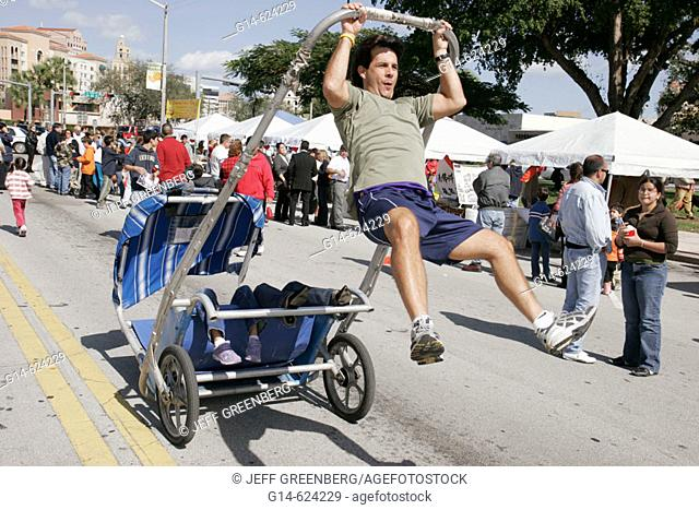 Florida, Coral Gables, Asian New Year Festival, rickshaw taxi, children ride, driver jumps