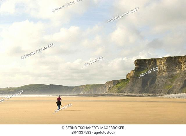 Woman walking on the beach, cliffs, coast, Nash Point, Glamorgan Heritage Coast, South Wales, Wales, United Kingdom, Europe