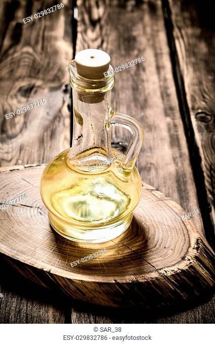 Olive oil on a wooden Board. On a wooden background