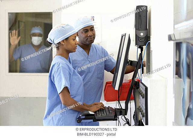 African American medical professionals looking at computer
