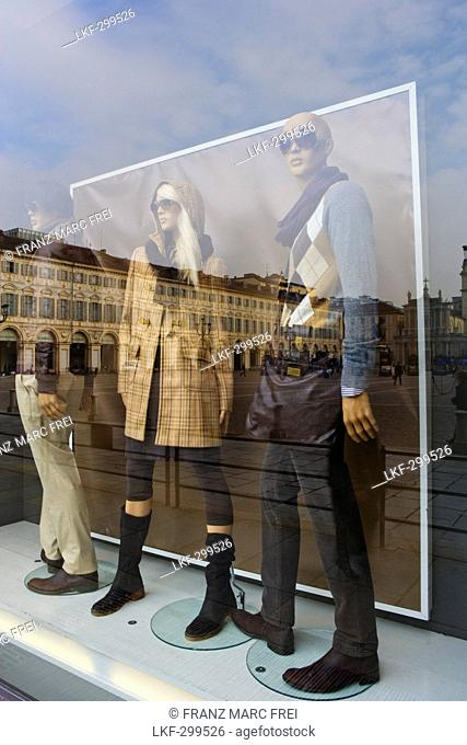 Shop window with reflection, Shopping in Via Roma, Turin, Piedmont, Italy