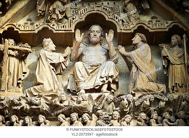 Tympanum of central west portal: Christ in Majesty presides over the Day of Judgement, supported by an array of saints. Gothic Cathedral of Notre-Dame, Amiens