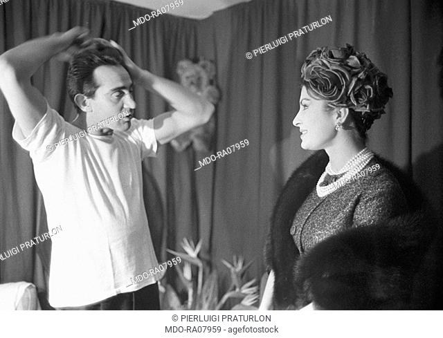 Italian actor Walter Chiari (Walter Annichiarico) being praised by the actress Silvana Pampanini in the dressing room after the theatre show performed by his...