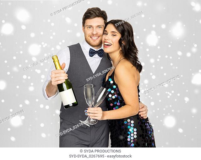happy couple with champagne celebrating christmas