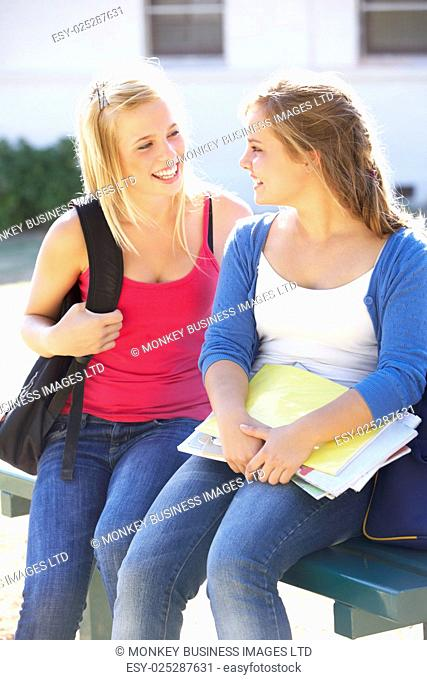 Two Female College Students Outside Campus Building