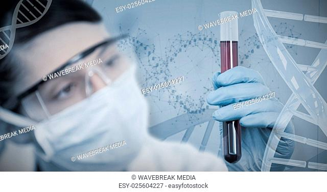 Composite image of female scientist conducting an experiment