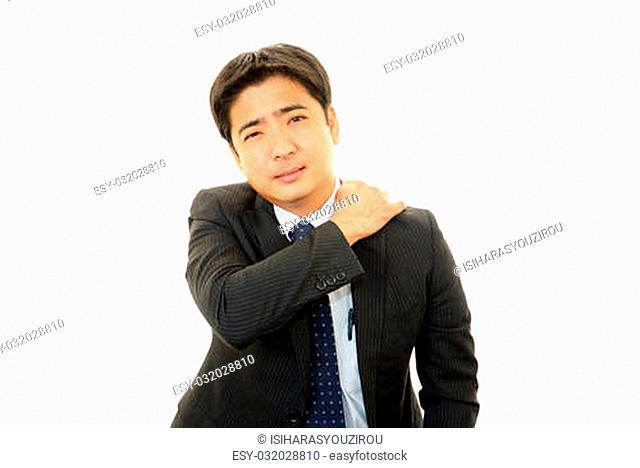 Businessman with shoulder neck pain
