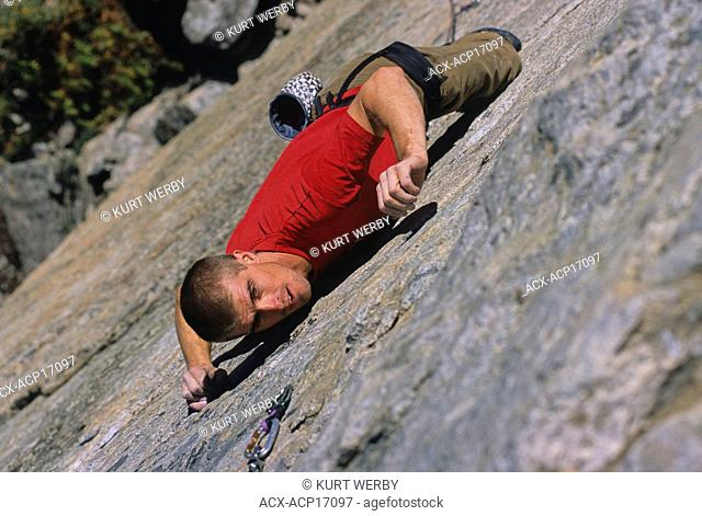 Rock climber, Doug Orr, climbing Naturopath 5.11b on The Doctor's Wall, Skaha Bluffs, Penticton, British Columbia, Canada