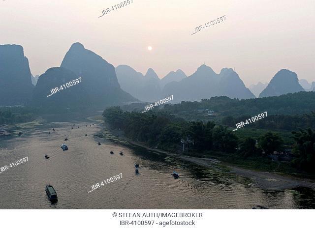 View from Yuping Hill, evening mood, sunset and karst mountains, boats on the Li River, Li Jiang, Yangshuo, near Guilin, Guanxi Autonomous Region