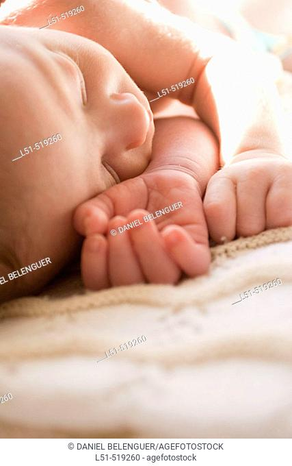 New born baby sleeping in the sun