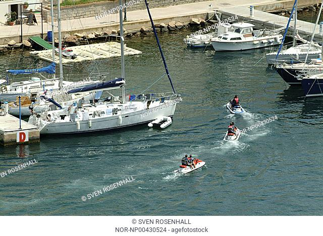 High angle view of people travelling in the boats at harbour, Corsica, France