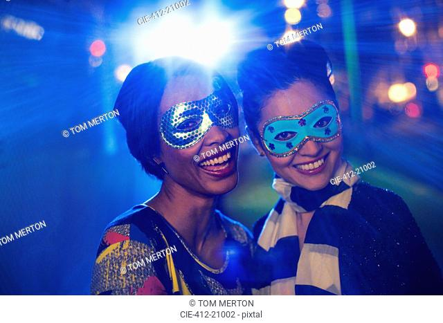 Women in masks smiling together