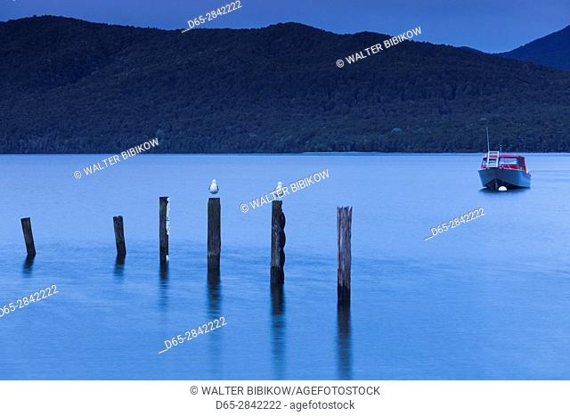 New Zealand, South Island, Southland, Te Anau, Lake Te Anau and boat, dawn