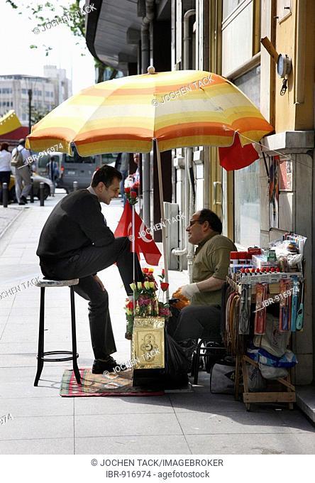 Shoeshine man on Taksim Square, Istanbul, Turkey